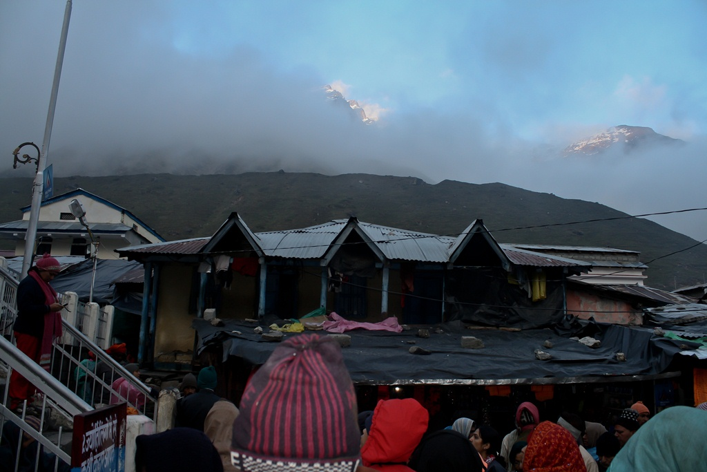 The imposing Sumeru range hidden in fog and clouds at Kedarnath temple