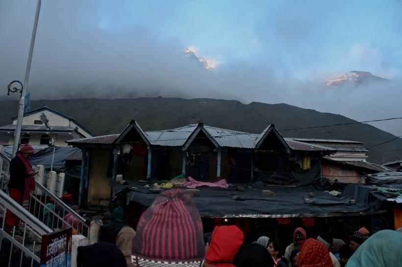 The imposing Sumeru range hidden in fog and clouds at Kedarnath temple