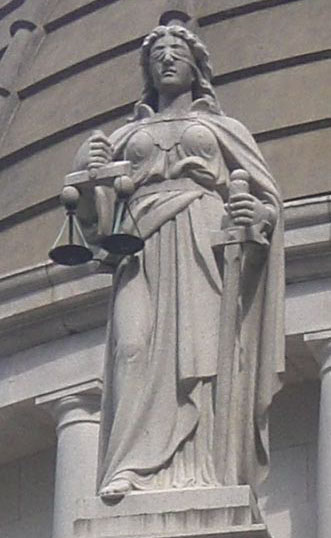 Lady of Justice Themes, armed with sword and balance scales (Courtesy: Wikipedia)