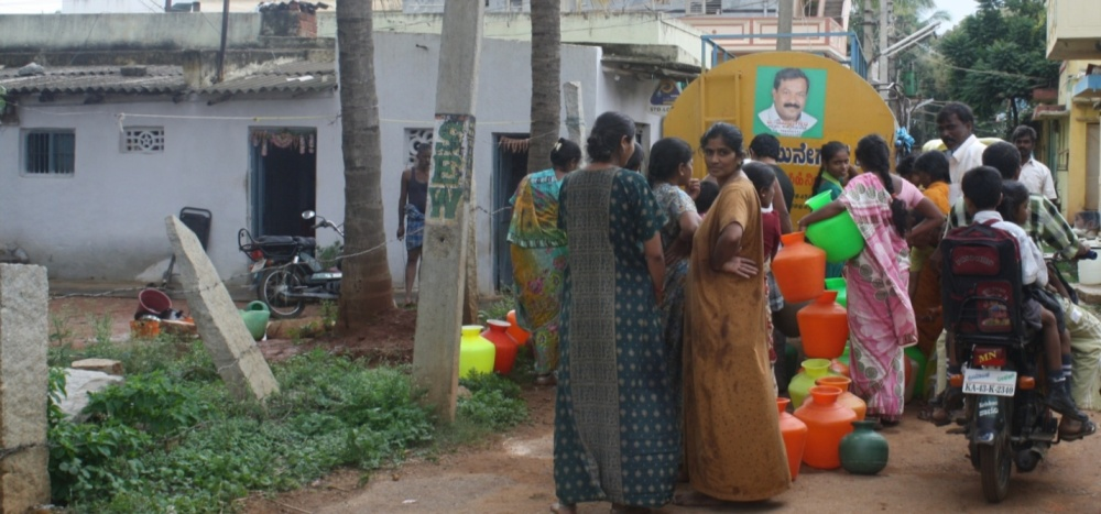 A water tanker supplying drinking water in a slum of Doddaballapura. Unlike many other tankers for which people pay as much as Rs 2.50 for a pitcher ( 7-8 liters), this tanker is sponsored by a local politician. (Pic from the report. Courtesy - Praveena Sridhar)