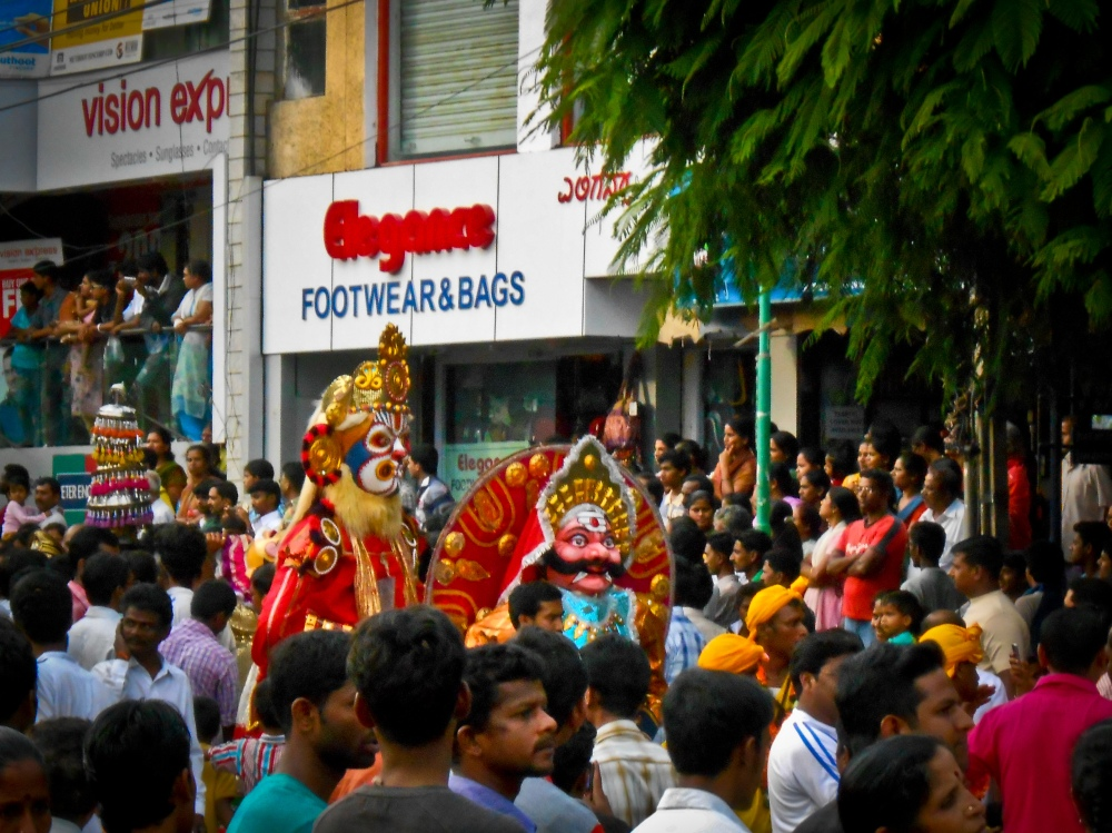 A procession with traditional dance form commemorating a Kannada filmstar Rajkumar's life