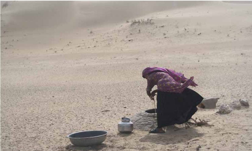A woman draws water from a beri (a traditional well), Barmer district, Rajasthan