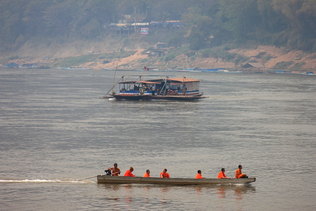 Barges and small boats continue to be the medium of reaching upper banks of Mekong in Luang Prabang